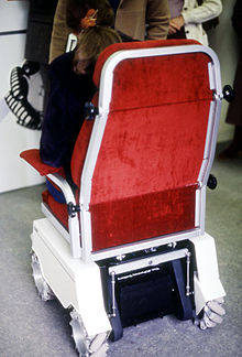 electric chair for stairs in india active sitting uk wheelchair wikipedia fitted with mecanum wheels taken at an exhibition the early 1980s
