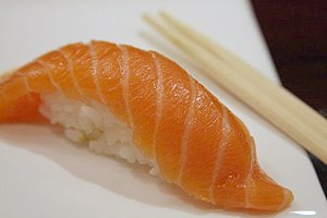 Salmon Nigiri Sushi with chopsticks, 2008.