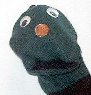 Um fantoche feito com meia (sock-puppet)