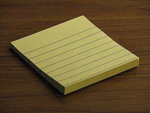 A small pad of Post-It notes.