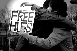 Photo of two people hugging on free hugs day i...