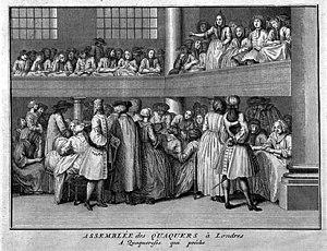 A female Quaker preaches at a meeting...