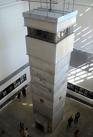 English: An exhibit featuring a three-story gu...