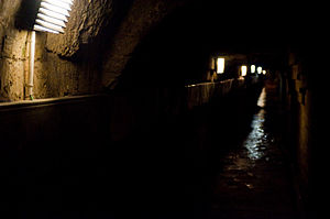 Entering the catacombes in Paris, a long, dark...