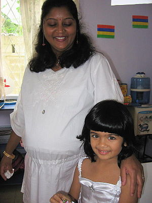 Child with teacher in Mauritius
