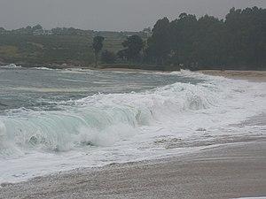 A wave breaks onto Carmel River State Beach