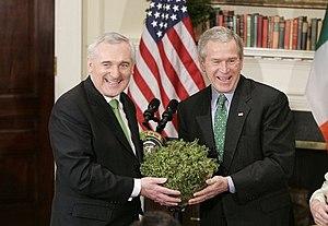 President George W. Bush accepts a bowl of sha...
