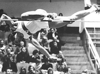 A high jumper performing the straddle techniqu...