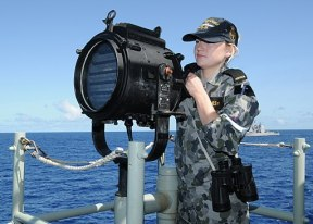 US Navy 100620-N-3327M-005 Able Seaman Communication Information Systems Operator Kaitlin Clohesy, assigned to the Australian navy guided-missile frigate HMAS Newcastle (FFG 06), demonstrates flashing light signals