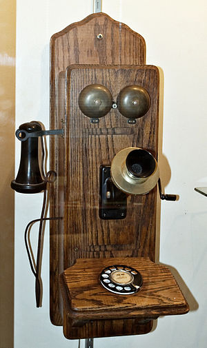 An early model wall mounted telephone, in the ...