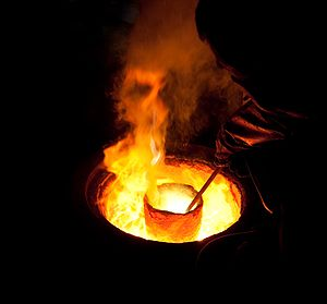 Melting metal in a ladle for casting