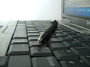 Photo of keyboard and pen