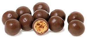 English: A pile of Maltesers candies and one s...