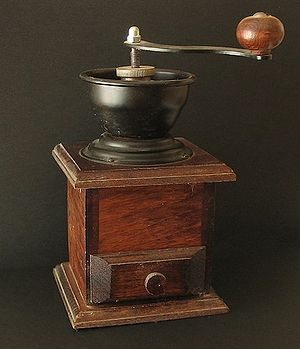 An old-fashioned manual burr-mill coffee grinder.