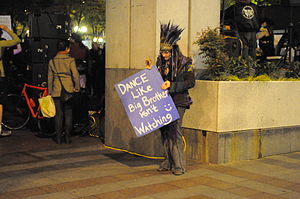 "English: Woman with sign ""Dance like Big ..."