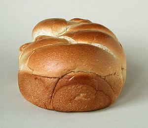 The crust of brioche bread is golden-brown due...