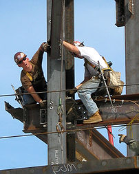 Two construction workers at work.