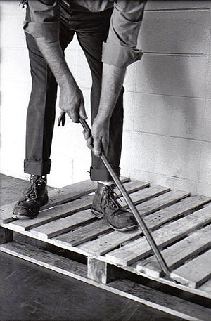 black / white photograph of a crowbar's usage.