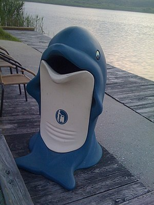 Trashcan in the shape of a dolphin, by the bay...