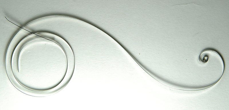 File:Mainspring Chinese uncoiled.jpg
