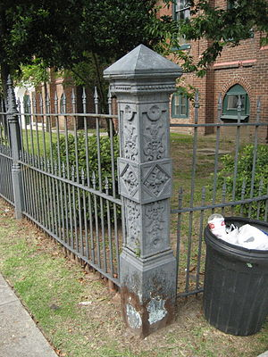 Old metal fence post, Uptown New Orleans