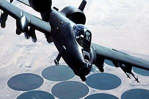 An A-10A Thunderbolt II aircraft flies over a ...