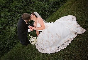 A bride and a groom kiss.