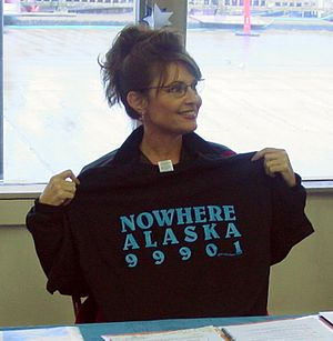 Sarah Palin holding a T-shirt related to the G...