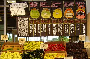 A display of hot peppers and a board explainin...