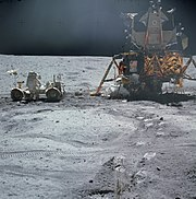 John Young works at the LRV near the LM Orion (NASA)