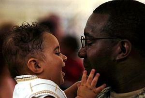 Pfc. Tierrine Wesley holds his 7-month-old son...