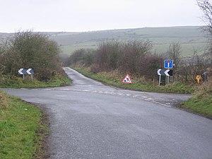 Main road left, no through road right, farm ah...