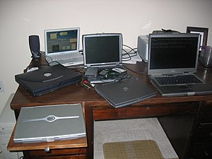Desk full of laptop computers
