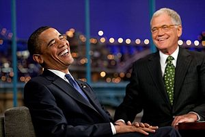 President Barack Obama laughs during the tapin...