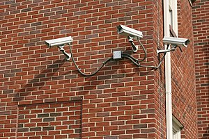English: A set of three security cameras on th...