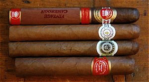 Four cigars of different brands (from top: H. ...