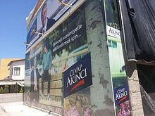 Poster promoting Mustafa Akıncı in Dereboyu Avenue, Northern Nicosia