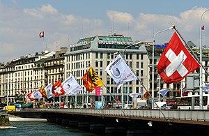 English: Mont-Blanc bridge and flags, Geneva. ...