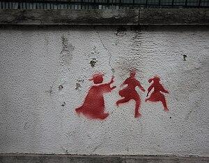 English: Graffiti on a wall in Lisbon depictin...