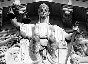 English: A statue of Justice on the tympanum o...