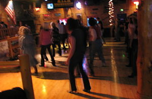 Line dancing at a Country Western Dance Hall a...