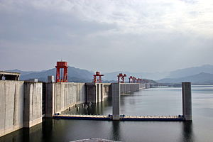 Three Gorges Dam spans the Yangtze River in Sa...