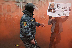 Dispersing of demonstrators, teenager is carry...