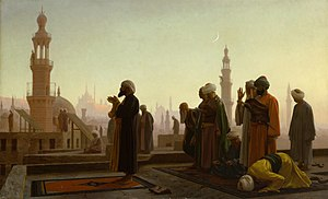 An Imam leading Maghrib prayers in Cairo, Egyp...