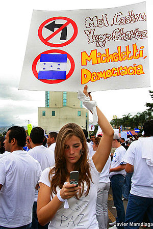 The sign opposes Manuel Zelaya, Fidel Castro, ...