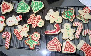 Snowmen, bells, and candy cane sugar cookies.