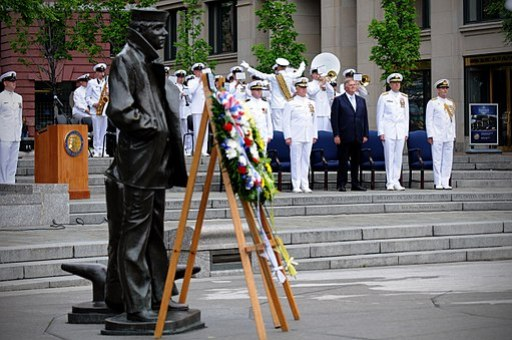 United States and Australian wreaths are laid near the Lone Sailor statue at the U.S. Navy Memorial during the 70th anniversary ceremony commemorating the Battle of the Coral Sea