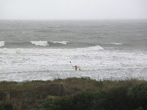 A surfer on the Atlantic Ocean near Isle of Pa...