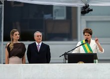 President Dilma Rousseff delivers her inaugural address as Vice President Temer and wife Marcela look on, 1 January 2011.