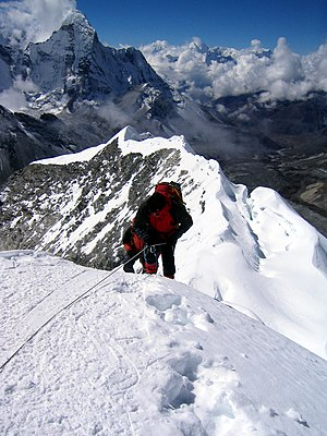 English: Climber taking the final few steps on...